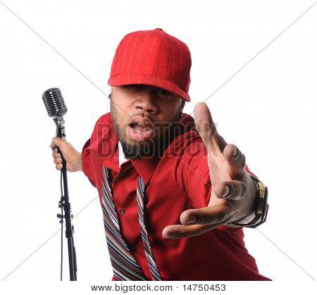 African American man dressed in red shirt and cap singing and holding vintage microphone