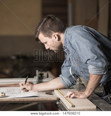 Carpenter Looking At The Plans