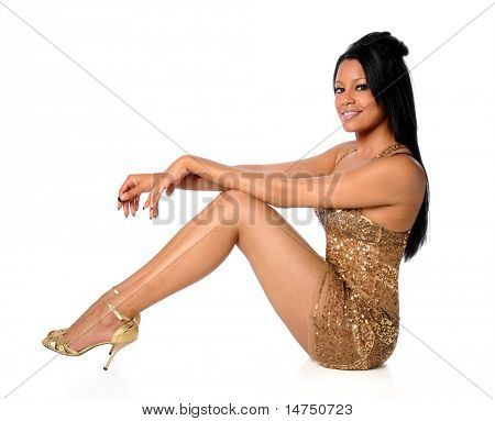 African American woman in golden dress isolated over white