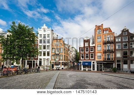 Amsterdam Netherlands - July 03 2016: The traditional Dutch houses on Singel street morning time