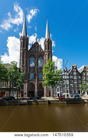 Amsterdam Netherlands - July 02 2016: De Krijtberg Church the Catholic church in the oldest district of the city located on Singel 446 sunny day