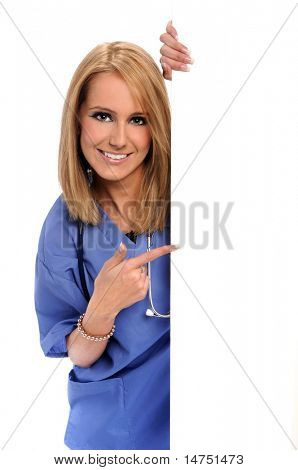 Health care worker pointing to blank sign