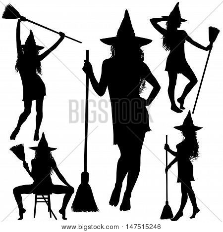 Black silhouettes of young beautiful Halloween witch standing with broomstick.