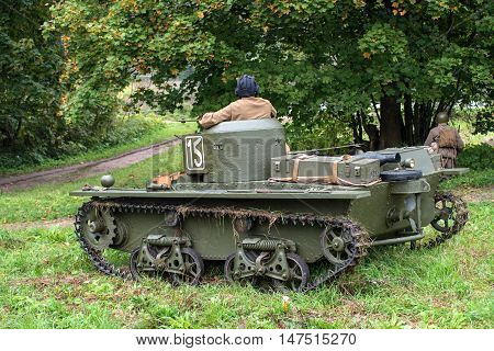 Gatchina, Russia - September 11, 2016: The historical reconstruction of World War II. Lightweight floating tank T-37A. The tank is in wait, guarding infantry.