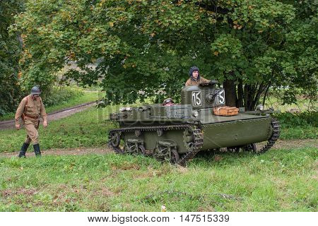 Gatchina, Russia - September 11, 2016: The historical reconstruction of World War II. Lightweight floating tank T-37A. Tank returns from exploration.