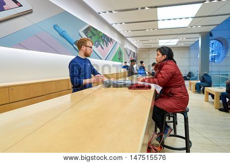 CHICAGO, IL - MARCH 24, 2016: inside of Apple store. Apple Store is a chain of retail stores owned and operated by Apple Inc., dealing with computers and consumer electronics.
