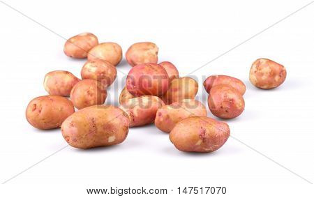 Raw fresh potatoes isolated on white background.