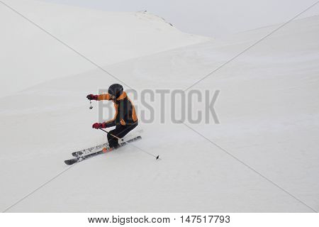 Skier Hoping Tails While Skiing In A Ski Slope