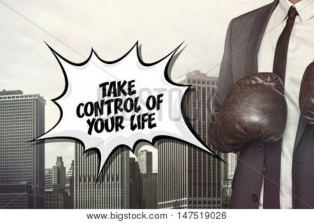 Take control of text on speech bubble with businessman wearing boxing gloves