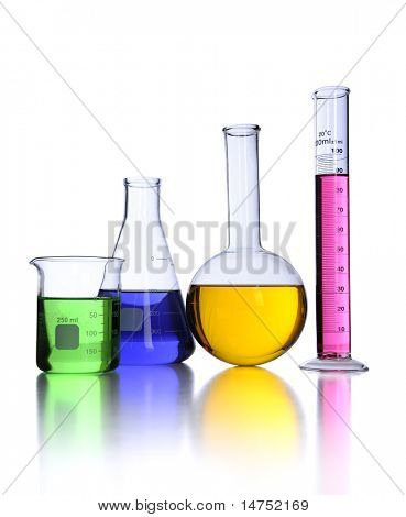 Laboratory glassware over white background with reflections on foreground