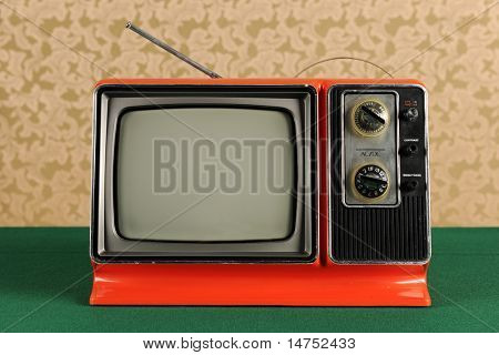 Orange vintage television in 1970s environment