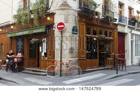 Paris France-September 10 2016: the traditional French cafe Au Bougnat set in a rustic bistro style located near Notre Dame cathedral on the isle de la Cite in the 4th district of Paris.
