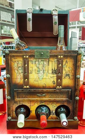 Decorative open the chest for storing wine bottles in the store's background.
