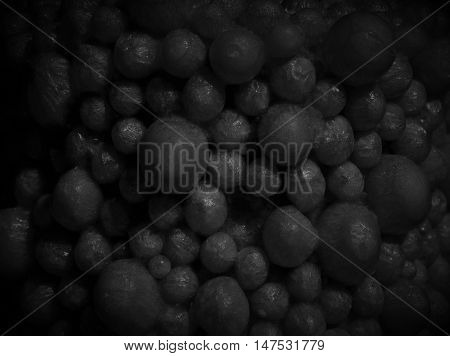 Dark grey beaded marble bulb bead balls pellet abstract background