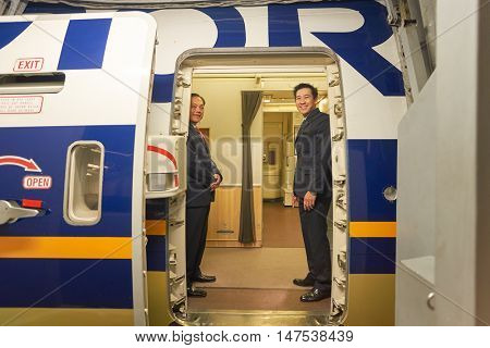 SINGAPORE - CIRCA SEPTEMBER, 2016: Singapore Airlines crew members on board of Boeing 777. Singapore Airlines Limited is the flag carrier of Singapore which operates from its hub at Changi Airport