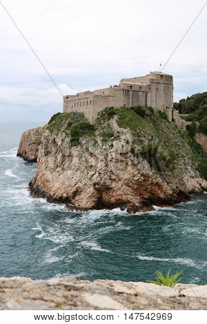 St Lawrence Fortress also known as Fort Lovrjenac is outside the western walls of the old town of Dubrovnik guarding the two entrances to the old town under an impending storm Croatia