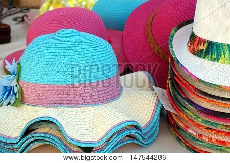 Bright Colorful Straw Hats For Men And Women Mostly White Blue Lilac Purple