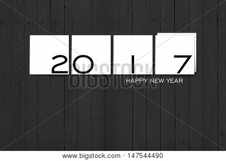 2017 Happy New Year Concept Texts on White Square Labels on Grey Wall Texture