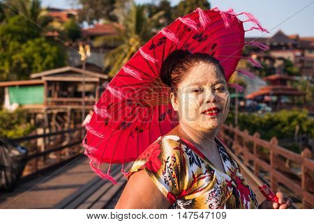 Sangkhla Buri, Thailand-January 4: Local people in western region of Thailand. The unique face of art painted with powder on January 4, 2015 in Sangkhla Buri, Thailand.