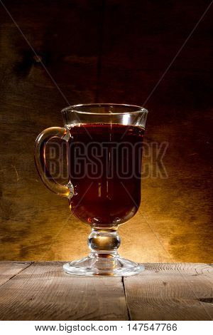 Glass of mulled wine on a wooden background