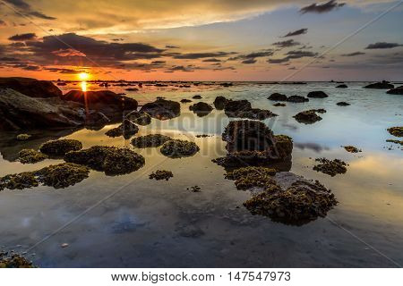 The golden hour sunset at UMS International Labuan Campus. The coral live fertile during low tide sea water.