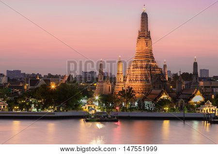 Arun temple river front with twilight sky background, Bangkok Thailand landmark