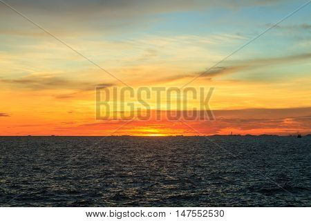Sunset at sea during twilight time with vivid colored and dramatic sky Thailand.