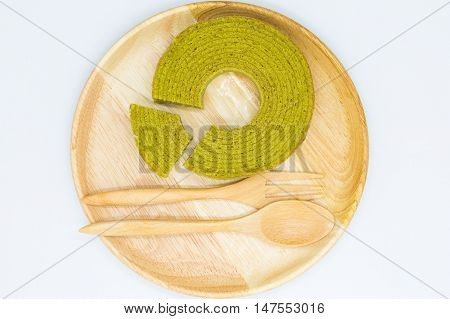 Green tea multiple layer cake on wooden plate, on white background