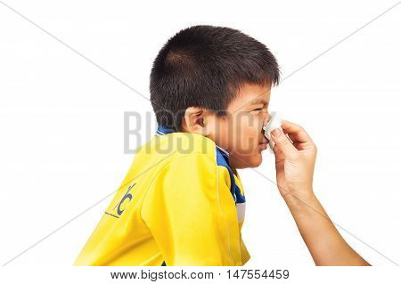 Mother cleaning nose to her son on white background