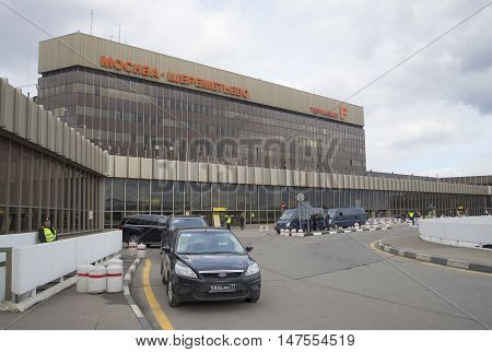 MOSCOW, RUSSIA - APRIL 15, 2015: Terminal F of Sheremetyevo international airport, cloudy april day. Tourist landmark of the city Moscow