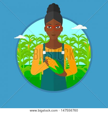 An african-american smiling farmer holding a corn cob on the background of corn field. Young happy female farmer collecting corn. Vector flat design illustration in the circle isolated on background.