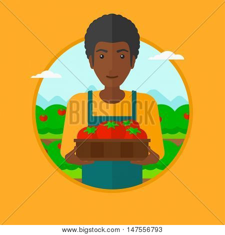 An african-american farmer holding a box with tomatoes. Happy farmer standing on the background of field with bushes of tomatoes. Vector flat design illustration in the circle isolated on background.