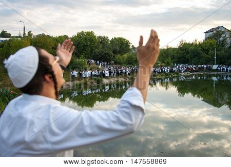 UMAN, UKRAINE SEPTEMBER 15, 2015: A Jewish man prays during celebration of Rosh Hashanah. Nearly 30,000 Jews have flocked to the Ukrainian town of Uman to celebrate Rosh Hashanah, the Jewish New Year.