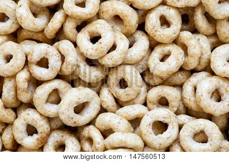Background of honey cheerios rings from above.