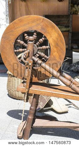 Manufacture, traditional spinning wheel for wool yarn, craft ancient instrument