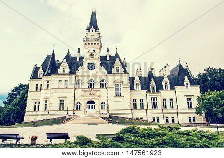 Beautiful Budmerice castle in Slovak republic. Yellow photo filter.