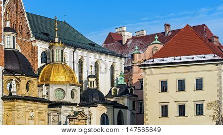 Gilded dome of the Cathedral Basilica of St. Stanislaus and Wenceslas in Krakow Poland at the Wawel Hill where Royal Castle is located.