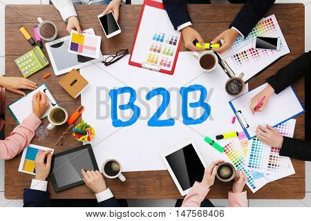 B2B business to business concept. Business people colleagues.