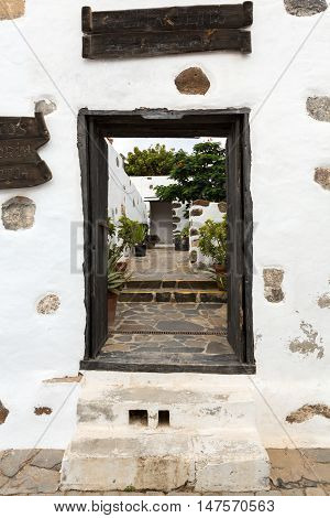 FUERTEVENTURA, SPAIN - SEPTEMBER 16, 2015: Old black entrance gate in Betancuria village on on Fuerteventura Canary Islands Spain