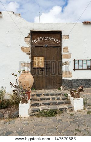 FUERTEVENTURA, SPAIN - SEPTEMBER 16, 2015: Old brown door in Betancuria village on Fuerteventura Canary Islands Spain