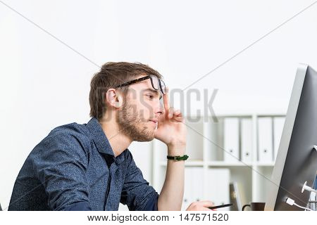 Man In Glasses Making Decision