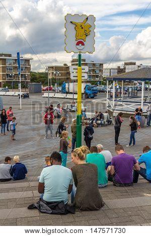 The Hague the Netherlands - September 17 2016: Pokémon GO hot spot at Kijkduin The Hague the Netherlands