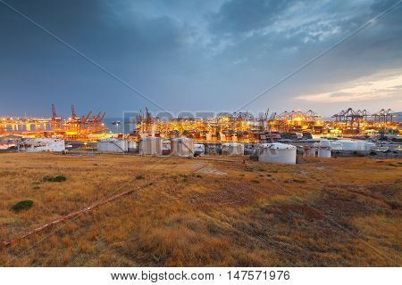 ATHENS, GREECE - SEPTEMBER 08, 2016: Container port of Piraeus at sunset on September 08, 2016.