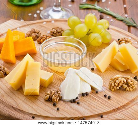 cheese with honey green grapes walnuts different cheeses parmigiano mozzarella olive oil gourmet