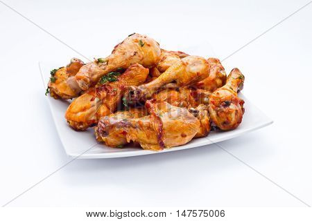 appetizing chicken legs on grill with golden crust and seasoning served in cafes restaurants snack bars steakhouse