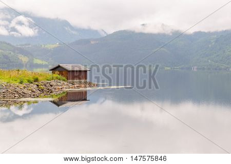 Wooden Cabin In The Shore Of A Fjord In Vorway