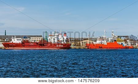 GDYNIA, POLAND - APRIL 10, 2016: Ships at the quay in the Port of Gdynia, the third largest seaport in Poland specialized in handling containers, ro-ro and ferry transport.