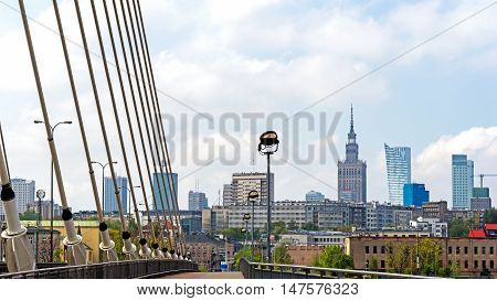 WARSAW, POLAND - MAY 2, 2016: Warsaw panorama taken out of The Swietokrzyski Bridge, first modern cable-stayed bridge in Warsaw, 479 m long with the tower 90m high build in 2000.