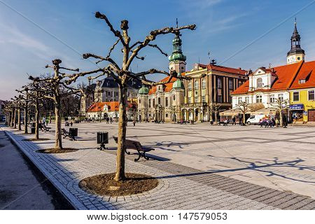 PSZCZYNA, POLAND - FEBRUARY 27, 2016: Lutheran church and town hall in the main square. City was founded 1303 and Lutheranism was introduced to Pszczyna in 1568 by Duke Karol Promnitz.