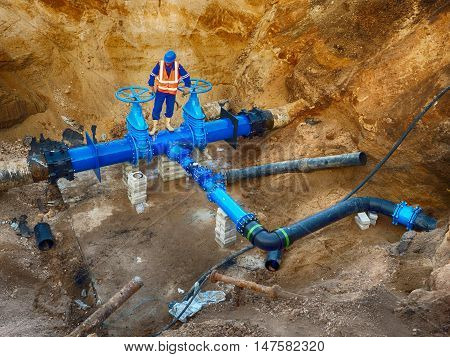 Worker Underground At  Gate Valve On Drink Water System, Waga Multi Joint Members.